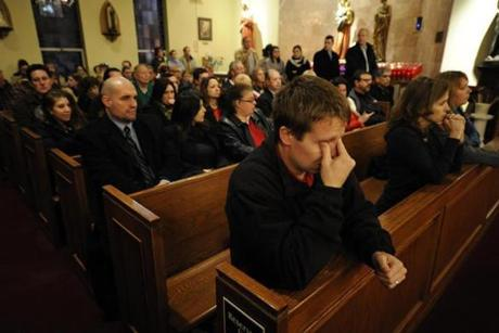 Mourners gathered inside the St. Rose of Lima Roman Catholic Church in Newtown at a vigil service.